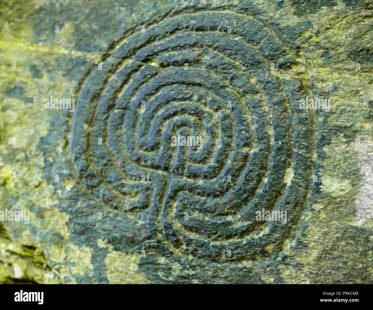 Carvings said to originate from Celtic fertility symbology in the stonework of the derelict Trethevy Mill in Rocky Valley, Cornwall, England, UK - Stock Image
