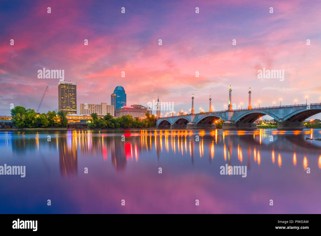 Springfield, Massachusetts, USA downtown skyline on the river at dusk. - Stock Image