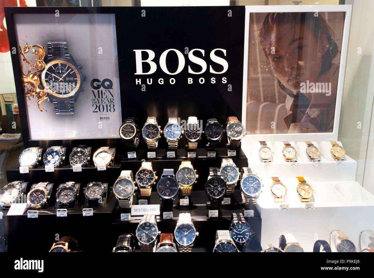 d1c84b114 Hugo Boss watch display in jewellers shop window, company founded in 1924  by Hugo Boss and is headquartered in Metzingen, Germany