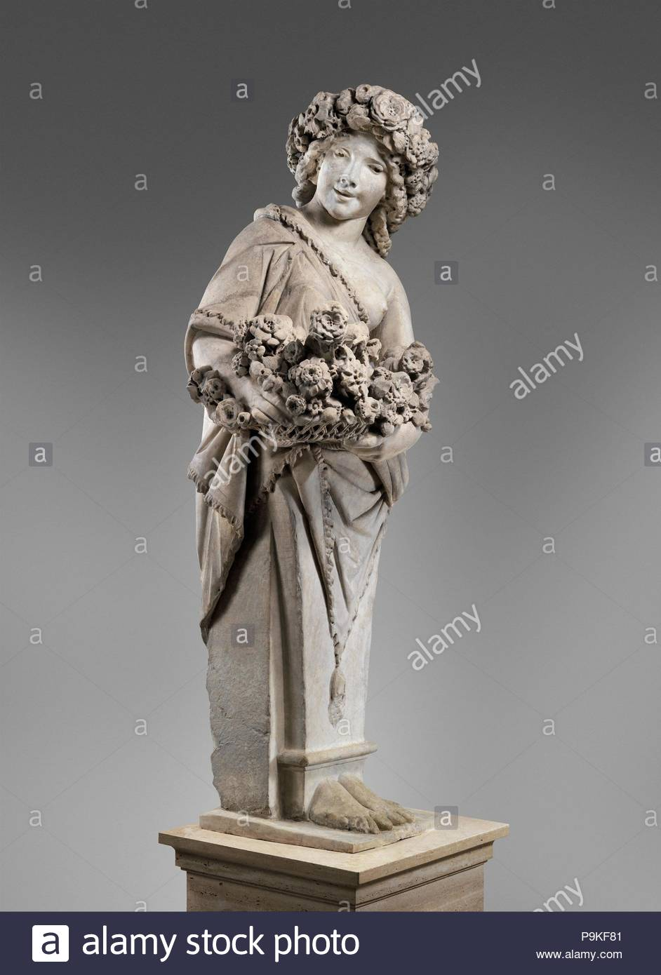 Spring in the guise of Flora (one of a pair), 1616–17, Italian, Rome, Marble, Overall (confirmed): 89 1/8 × 34 3/8 × 27 1/2 in., 2507 lb. (226.4 × 87.3 × 69.9 cm, 1137.2 kg), Sculpture, Pietro Bernini (Italian, 1562–1629), Assisted by Gian Lorenzo Bernini (Italian, Naples 1598–1680 Rome), The two terms were made in 1616 by Pietro Bernini (1562–1629) with the assistance of his more famous son, the sculptor Gian Lorenzo Bernini (1598–1680), for Cardinal Scipione Borghese. Each consisting of a half-body merging into a tapering pedestal, they originally stood in the gardens of the Villa Borghese i - Stock Image