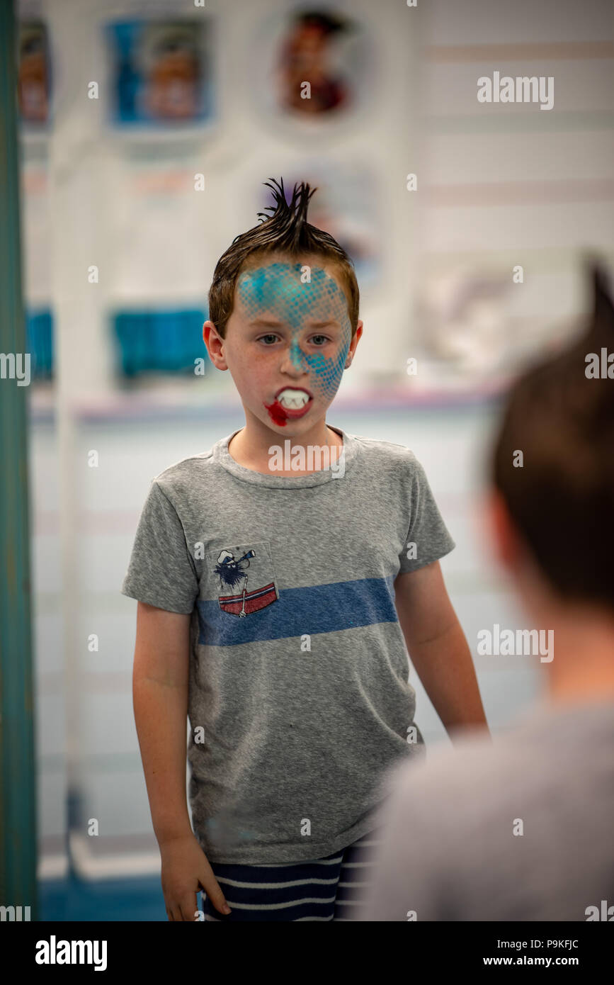Boy with face painted like a shark - Stock Image