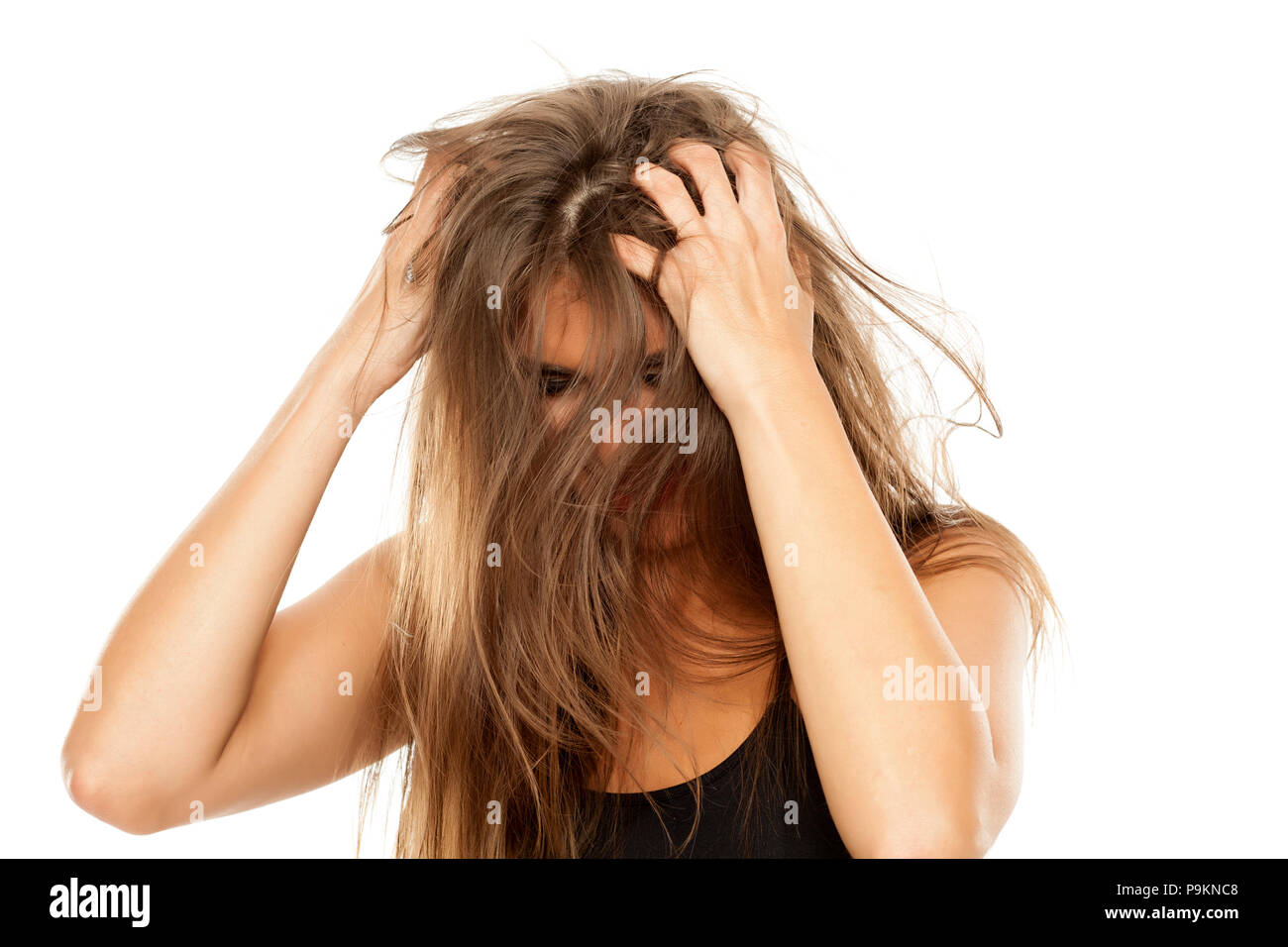 young beautiful woman has itching in her hair Stock Photo
