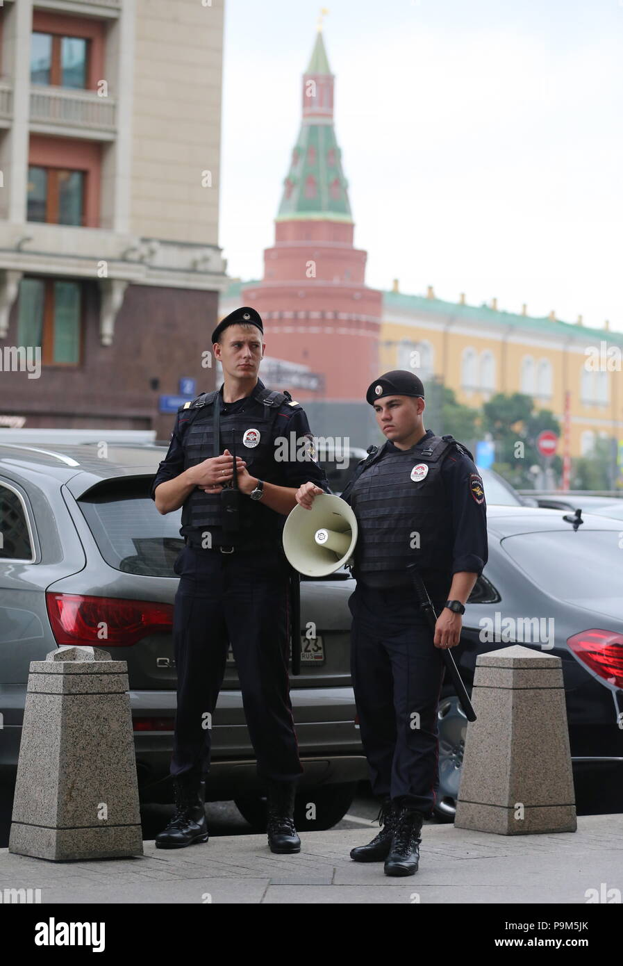 Moscow, Russia. 19th July, 2018. MOSCOW, RUSSIA - JULY 19, 2018: Police officers during a rally outside the building of the Russian State Duma ahead of the first reading of a draft law on raising the retirement age from 60 to 65 for men, and from 55 to 63 for women over a 15-year period. Vladimir Gerdo/TASS Credit: ITAR-TASS News Agency/Alamy Live News - Stock Image