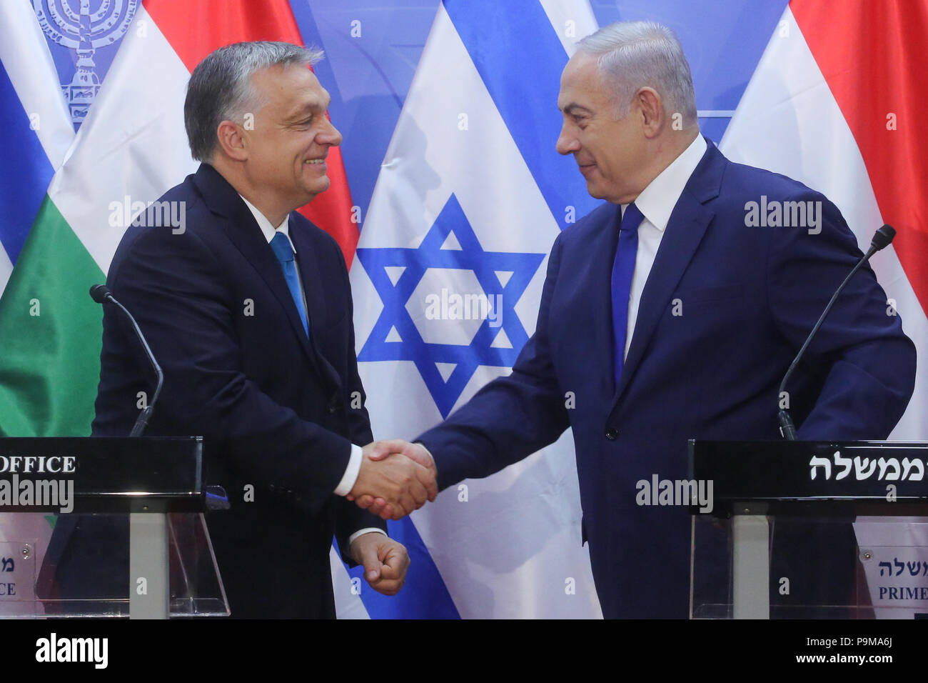 (180719) -- JERUSALEM, July 19, 2018 (Xinhua) -- Israeli Prime Minister Benjamin Netanyahu (R) shakes hands with Hungarian Prime Minister Viktor Orban during a joint press conference in Jerusalem, on July 19, 2018. Viktor Orban, known for his nationalist policies that have raised worries among Hungary's Jewish community, pledged 'zero tolerance' for anti-Semitism on a visit to Israel Thursday. (Xinhua/JINI/Marc Israel Sellem) - Stock Image