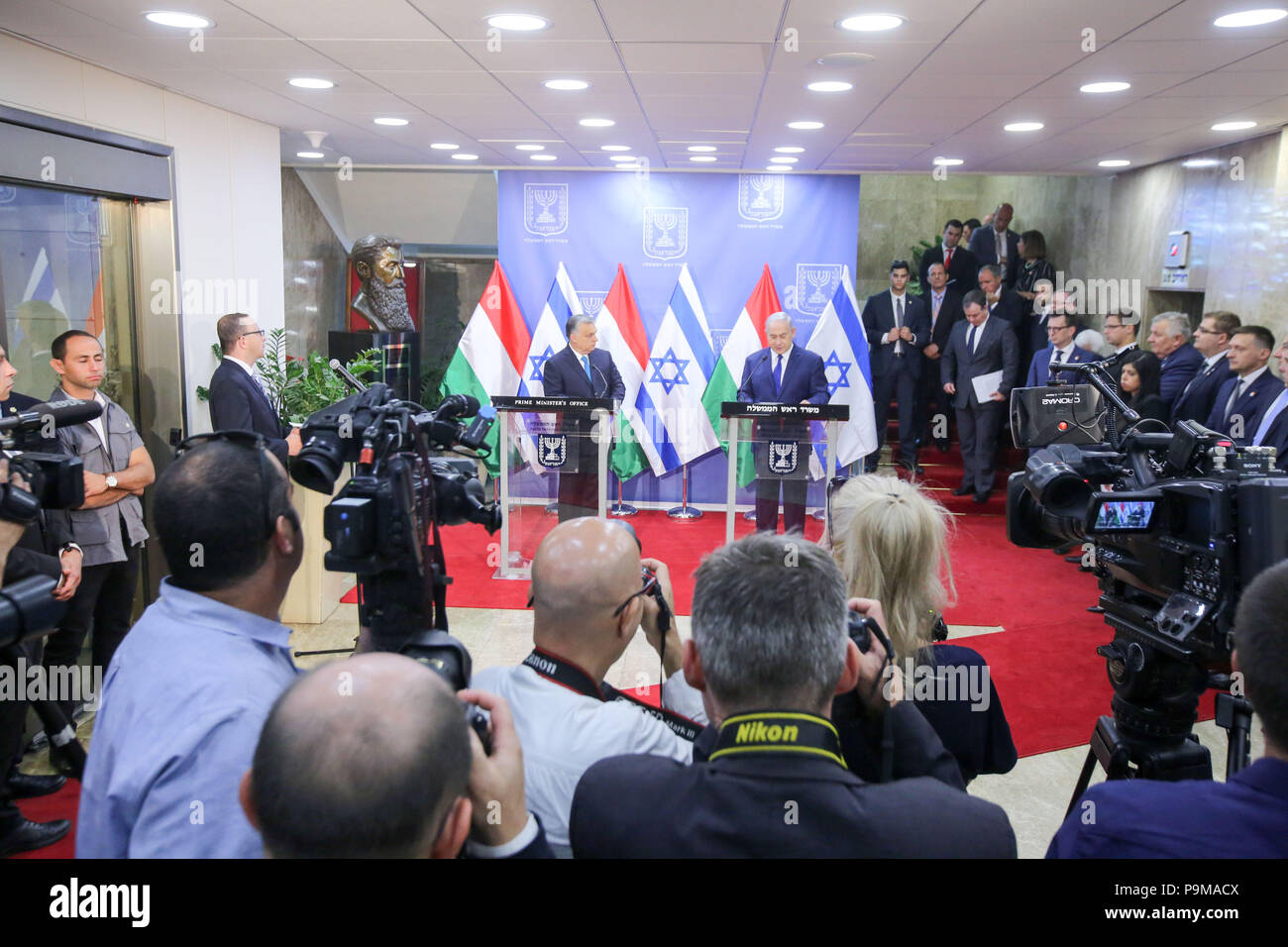 Jerusalem. 19th July, 2018. Israeli Prime Minister Benjamin Netanyahu (R, Center) and Hungarian Prime Minister Viktor Orban (L, Center) attend a joint press conference in Jerusalem, on July 19, 2018. Viktor Orban, known for his nationalist policies that have raised worries among Hungary's Jewish community, pledged 'zero tolerance' for anti-Semitism on a visit to Israel Thursday. Credit: JINI/Marc Israel Sellem/Xinhua/Alamy Live News - Stock Image