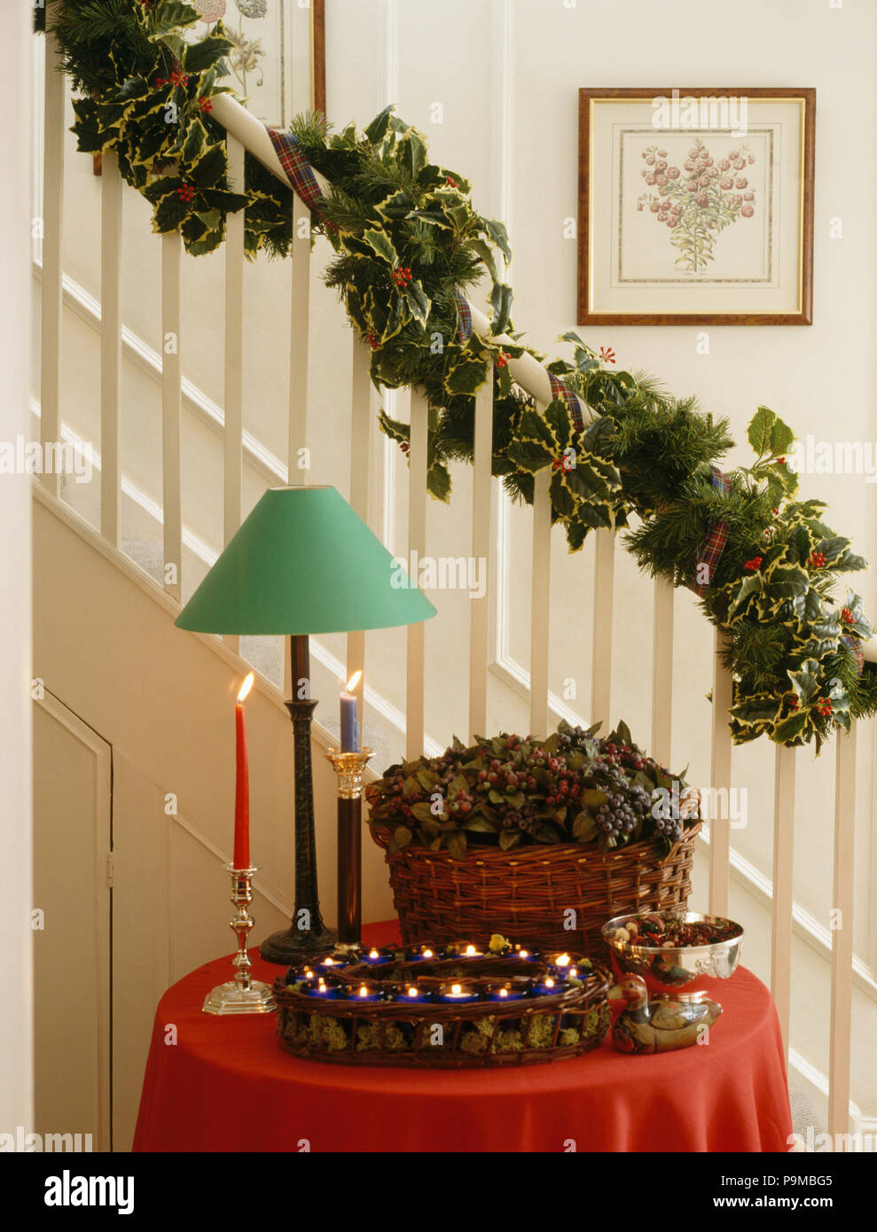 Christmas Garland On Staircase Above Green Lamp And Decorations On