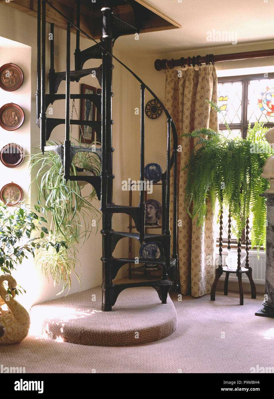 Wrought Iron Spiral Staircase In Small Hall With Boston Fern On Pedestal  Table
