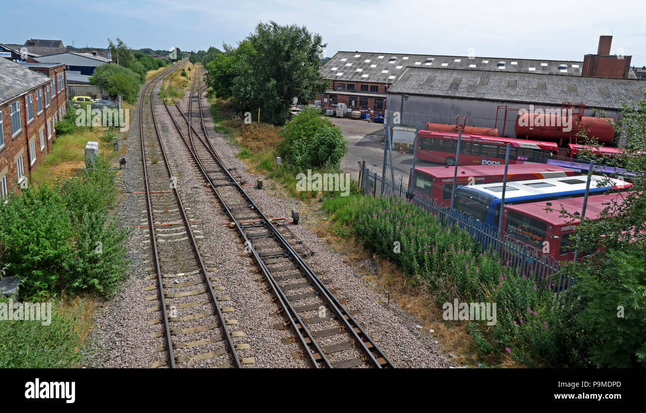 Latchford railway sidings, Bridgefoot Warrington, Cheshire, England UK with Bus Garage in foreground - Stock Image