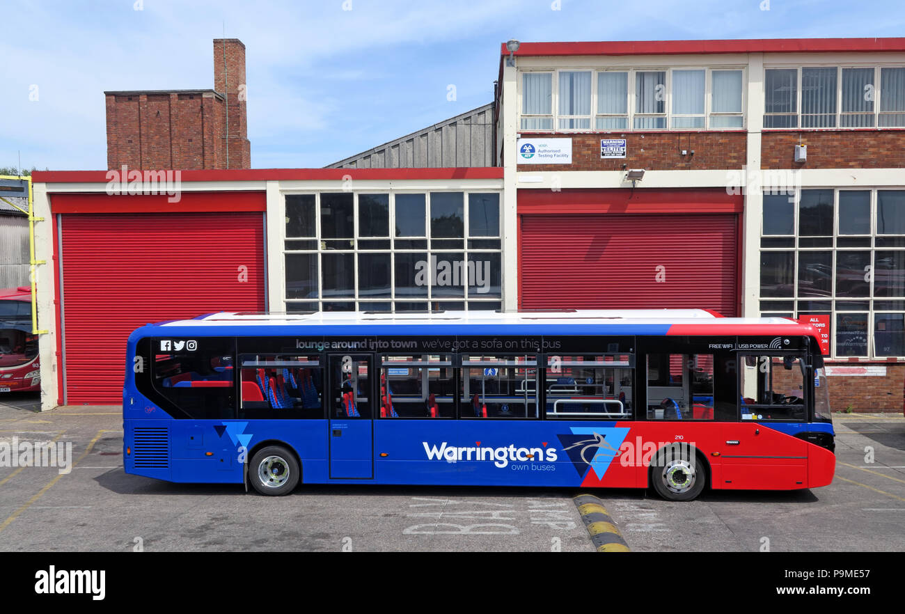 Warringtons Own Buses, main depot with bus outside,  Wilderspool Causeway, Cheshire, North West England, UK - Stock Image