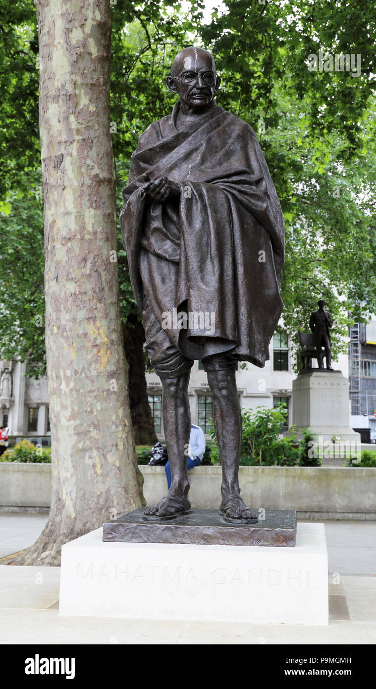 The bronze statue of Mahatma Gandhi in Parliament Square, Westminster, London, is a work by the sculptor Philip Jackson. - Stock Image