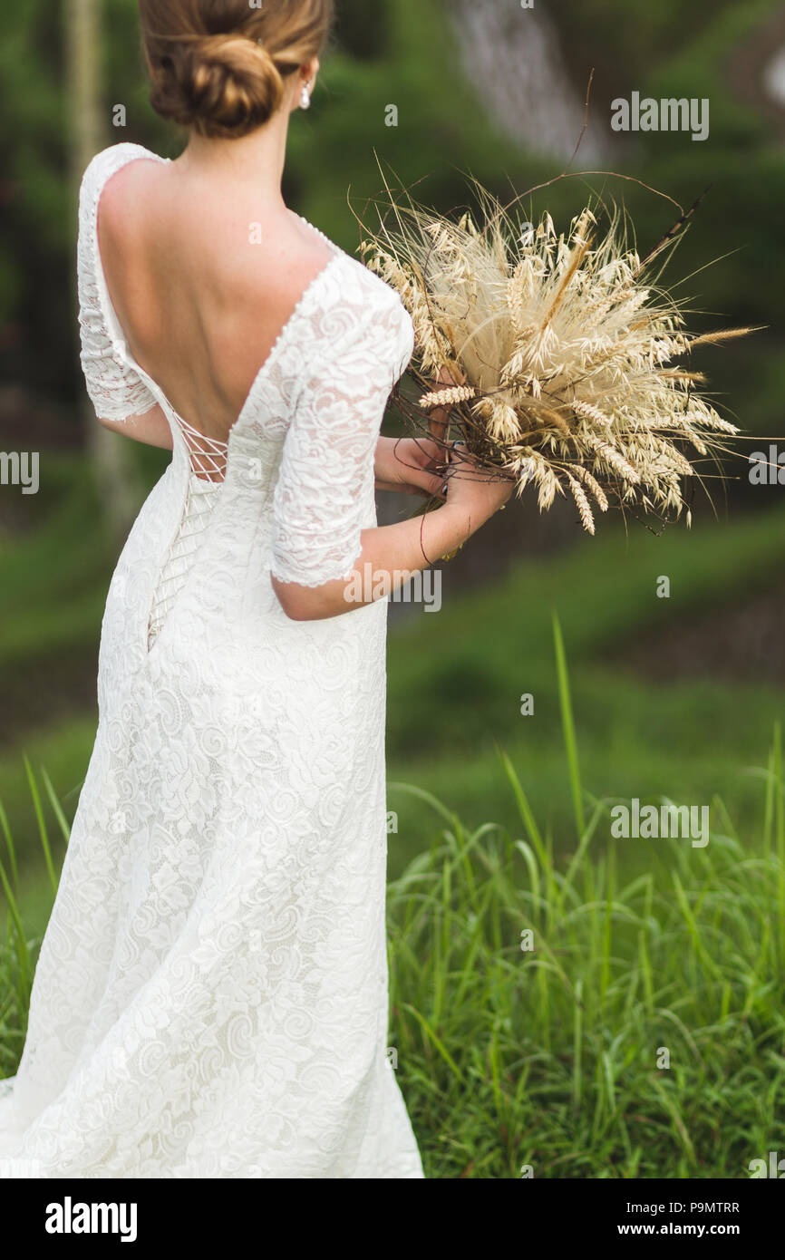 Wedding bouquet with dried flowers and spikelets Boho style in ...