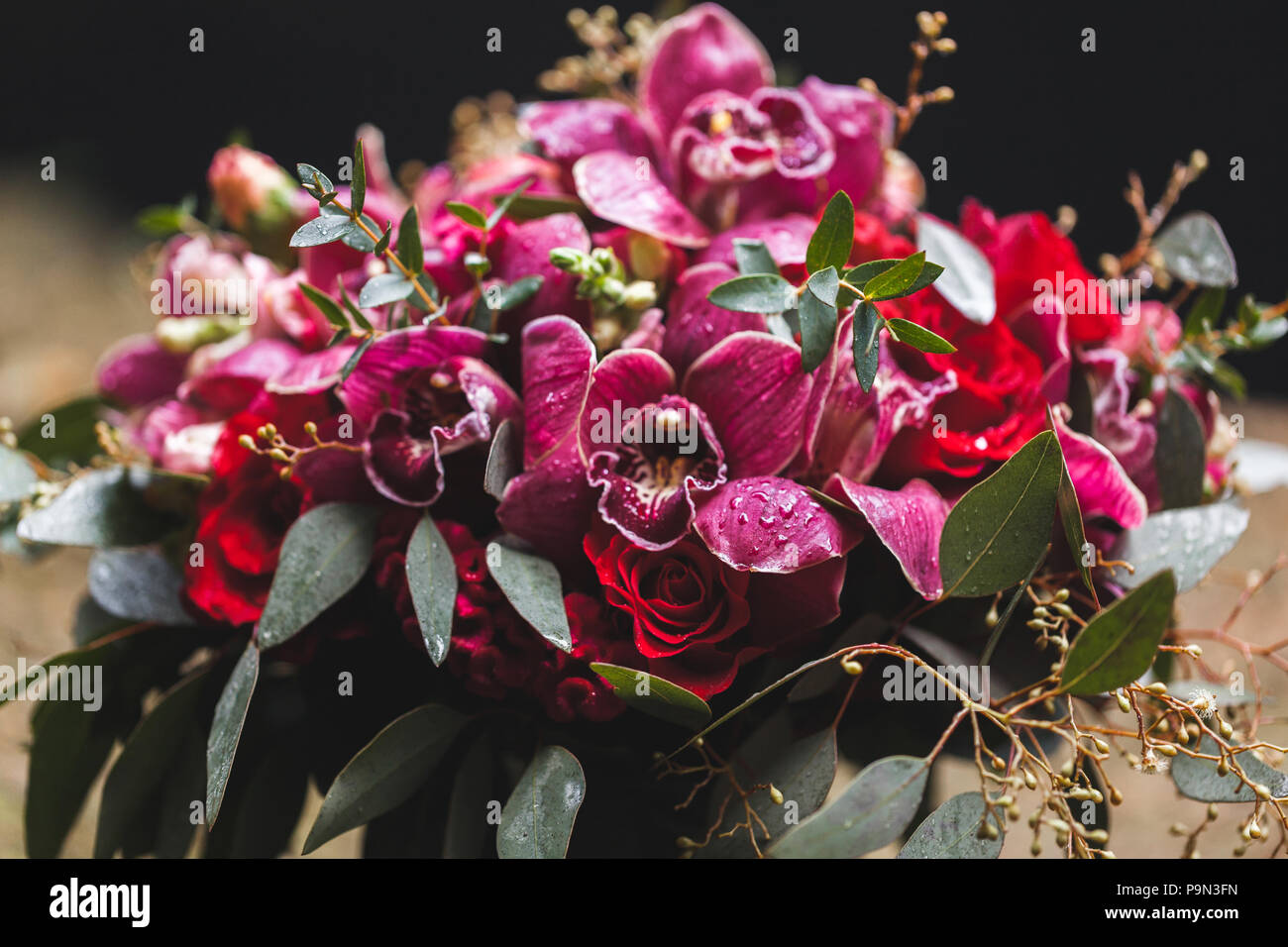 Wedding Flower Decorations With Pink And Red Orchids Green Leaves
