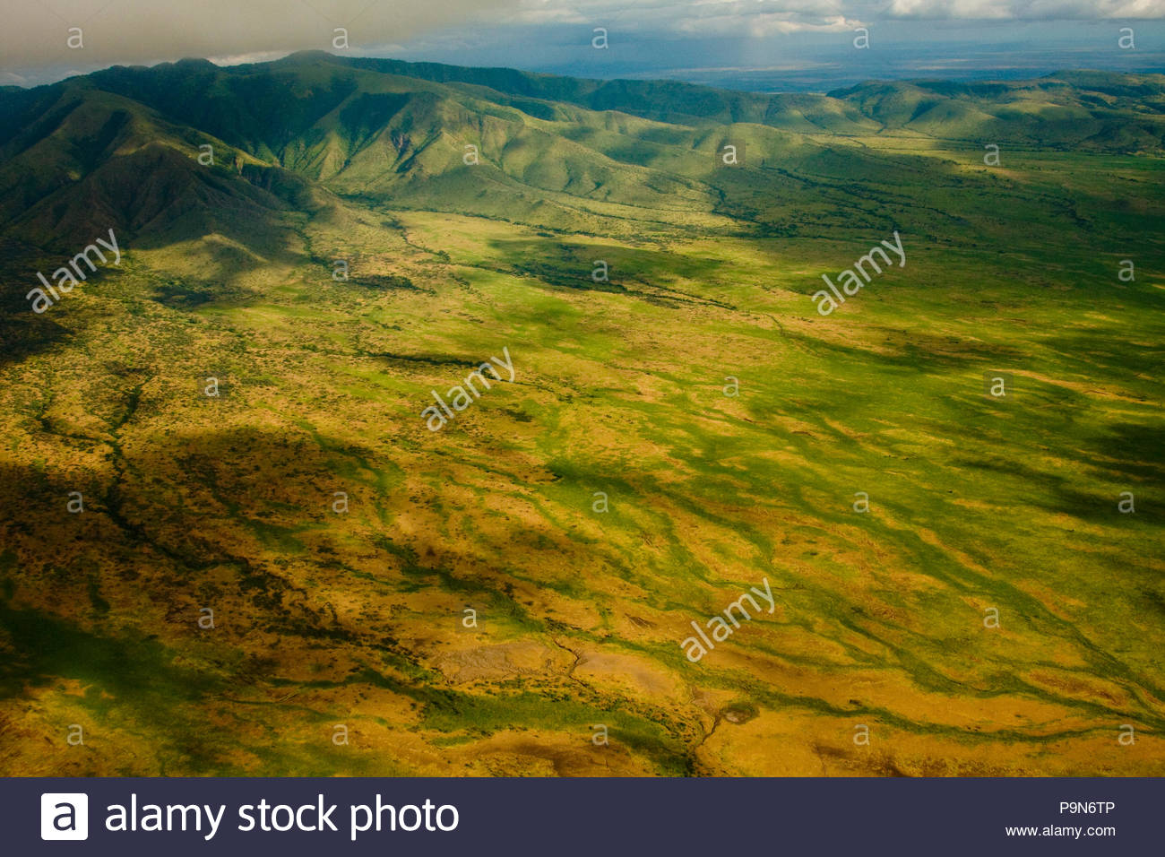 Aerial of mountains and farmland near Lake Manyara, Tanzania. - Stock Image