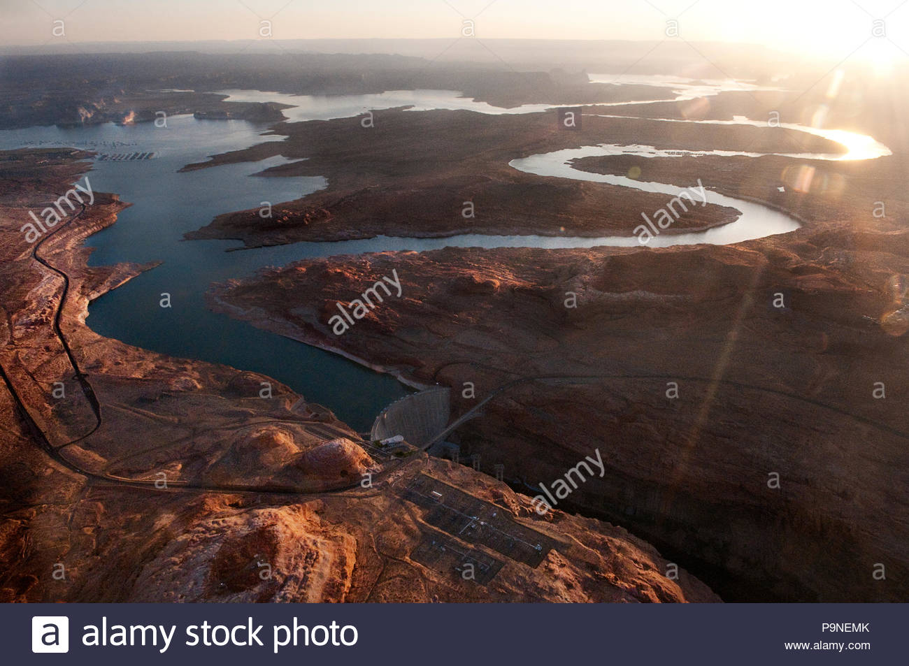 Aerial view looking down on Lake Powell and the Glen Canyon dam. Stock Photo
