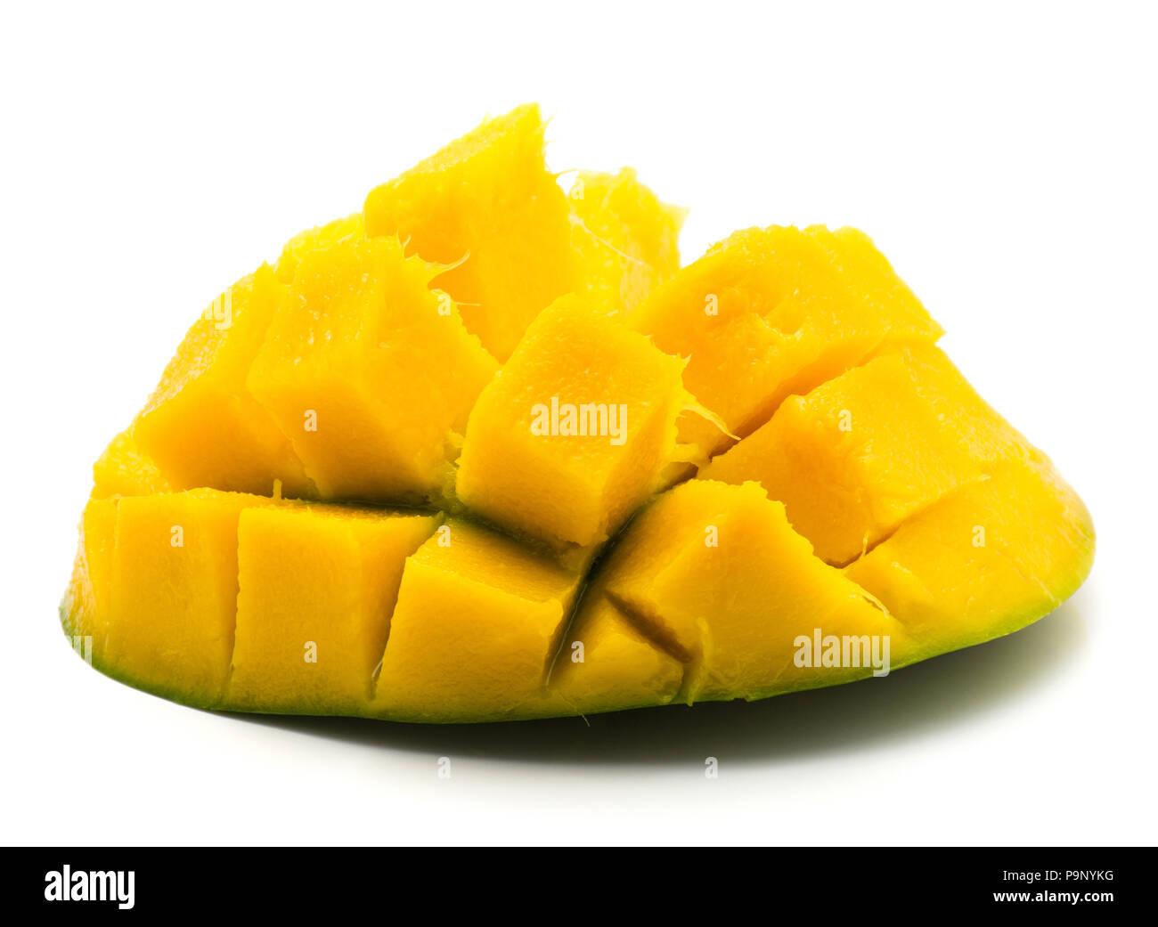 Sliced mango hedgehog shape isolated on white background one half - Stock Image