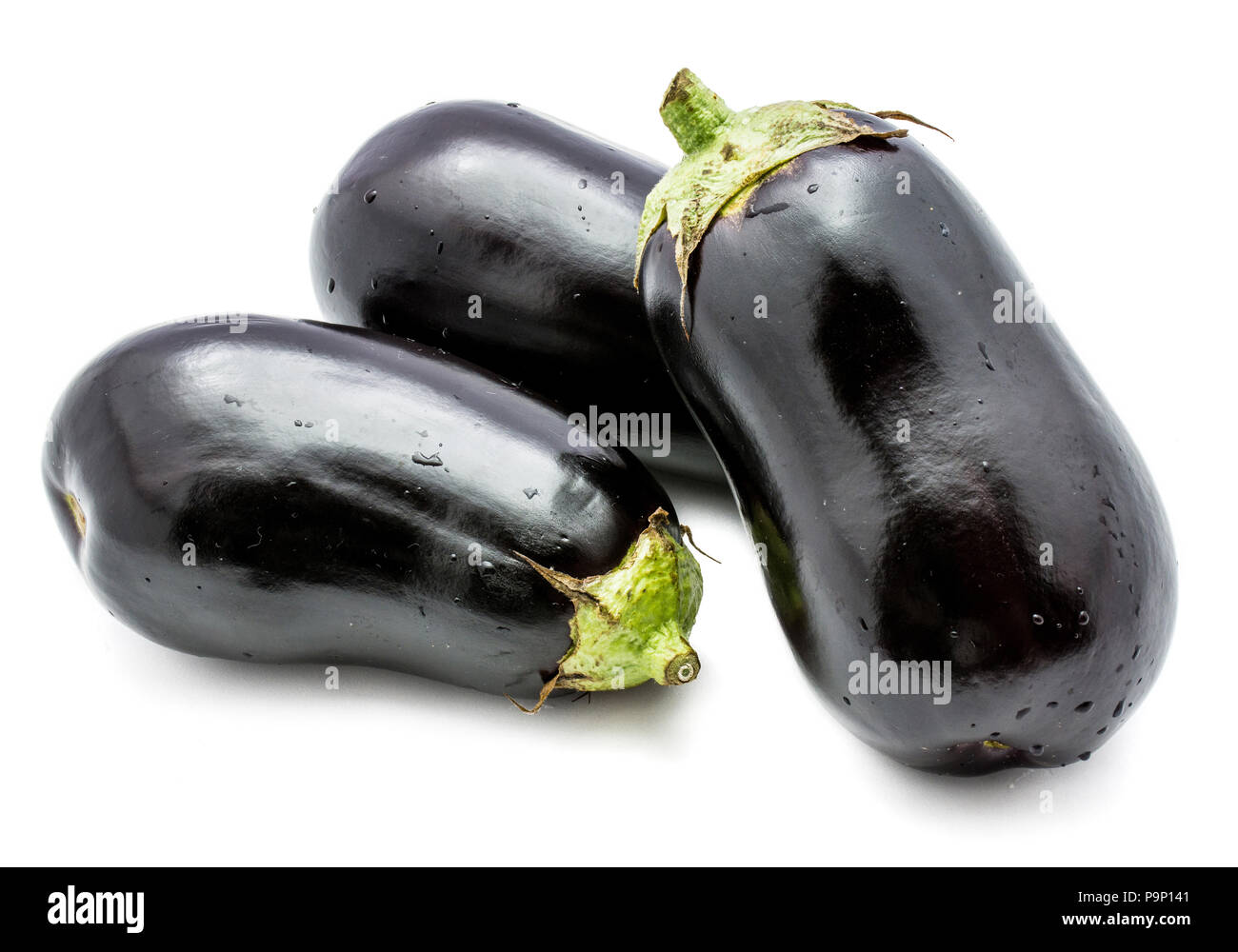 Three whole eggplants (aubergine) isolated on white background - Stock Image