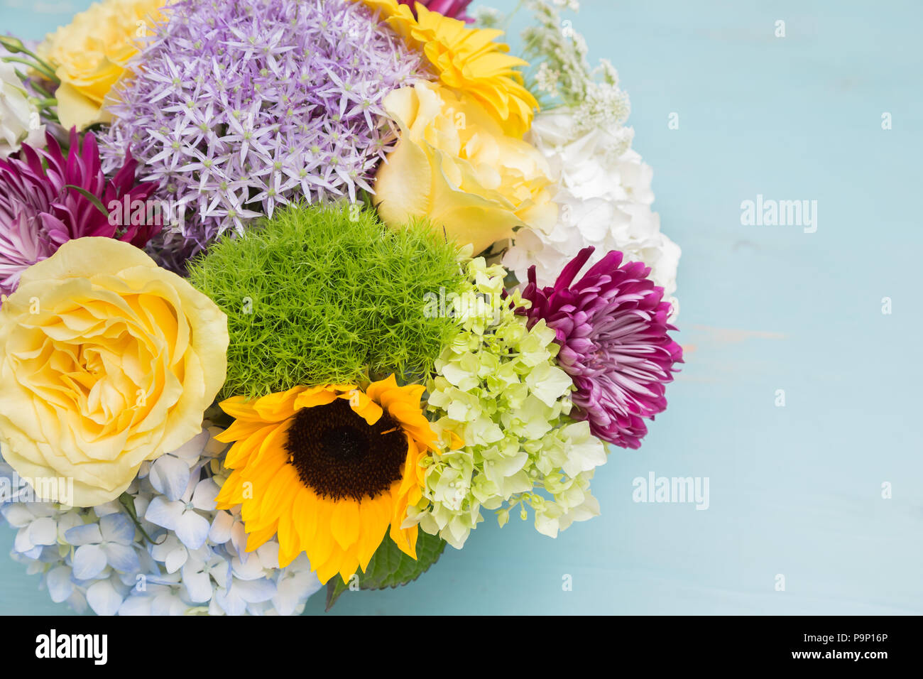 Beautiful Table Top Arrangement Of Many Different Types Of Flowers