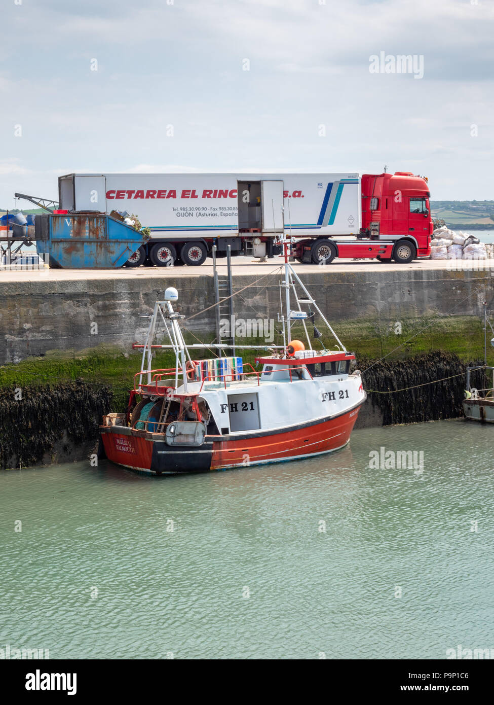 A Spanish lorry on the quay at Padstow Harbour Cornwall UK being loaded with fish caught in the UK for export to Spain and Europe - Stock Image
