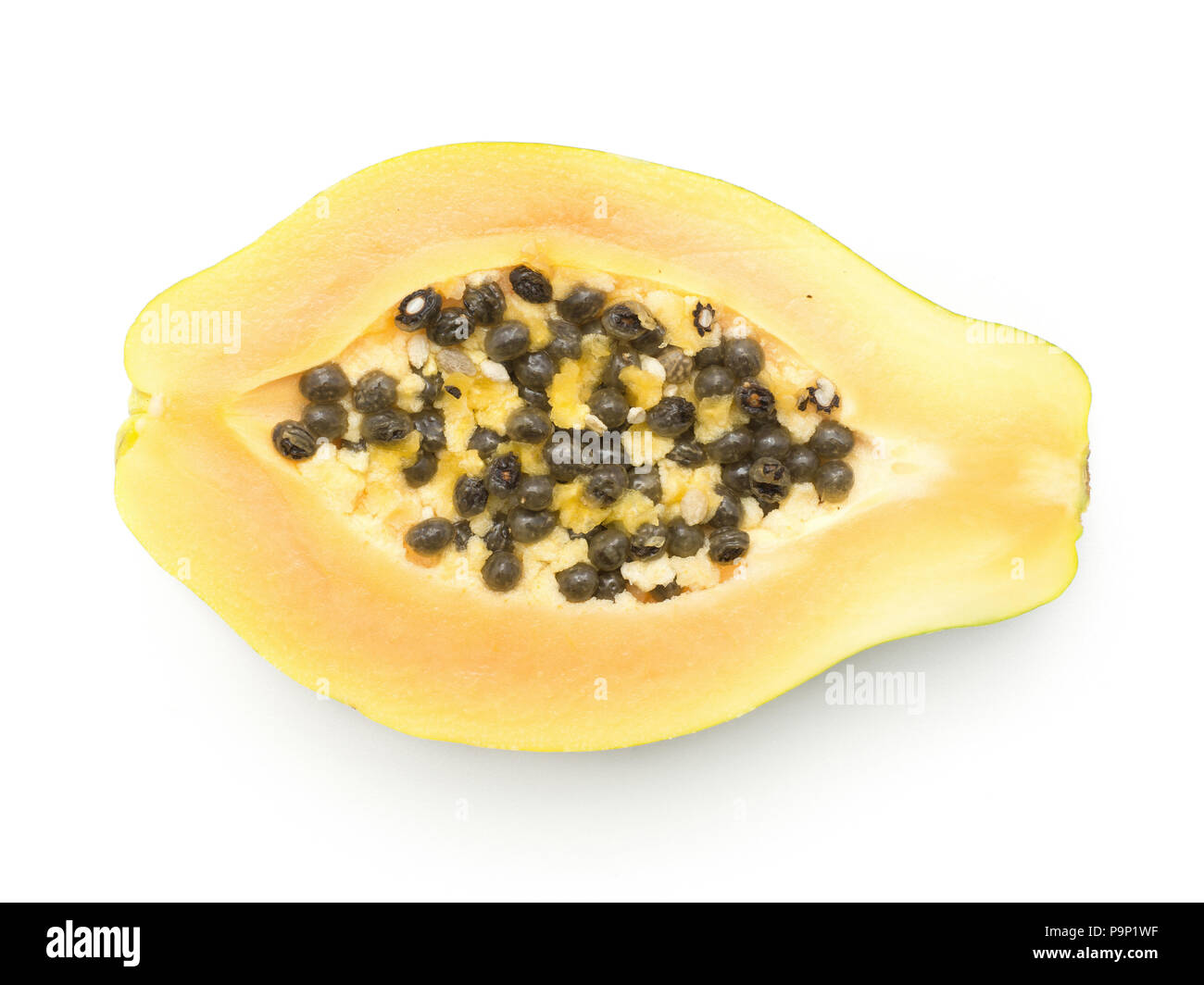 Green papaya half (pawpaw, papaw) top view with seeds orange flesh isolated on white background - Stock Image