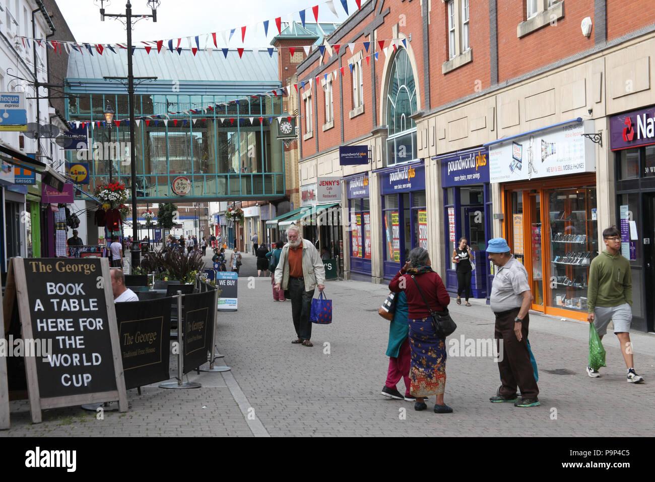 A shopping precinct in Aldershot, UK. - Stock Image