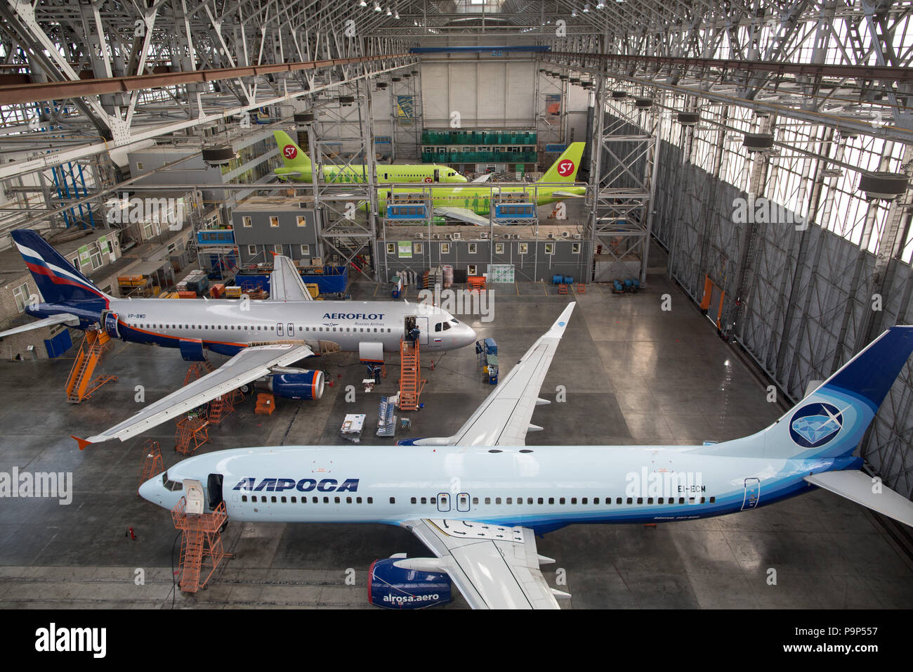 Civil jet airplanes of Alrosa, Aeroflot Russian Airlines and S7 Airlines pictured inside the S7 Engineering maintenance facility located at Domodedovo - Stock Image