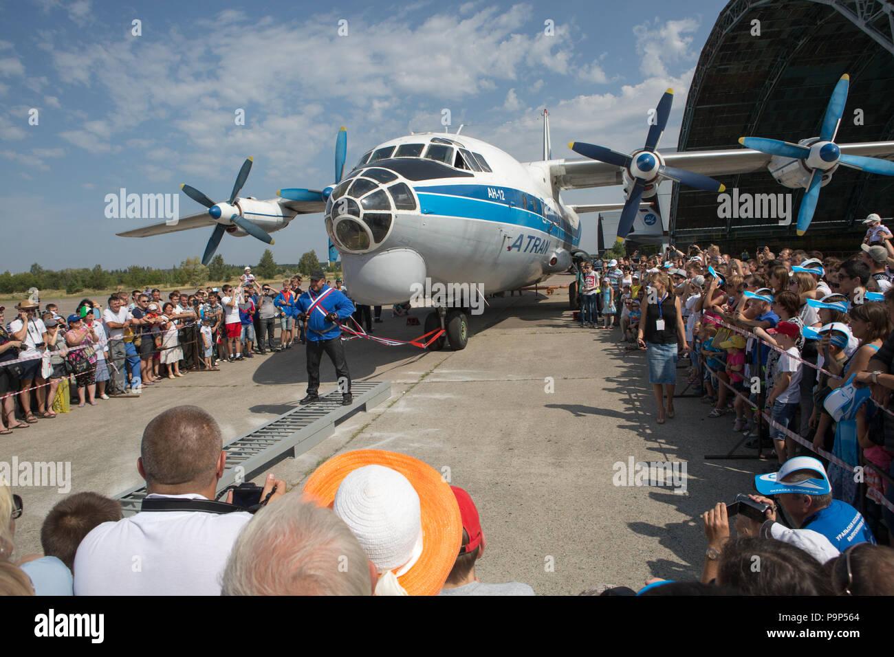 Vyacheslav Maksyuta, a Russian powerlifter prepares to move 50-tonnes heavy Antonov An-12 airplane at the public event near Ulyanovsk, Russia - Stock Image