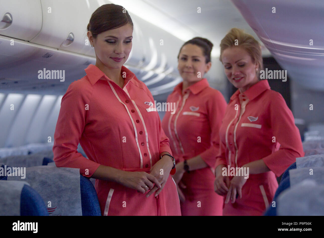 Flight attendants of Red Wings Airlines pictured  inside the 4th Sukhoi Superjet-100 in the airline's fleet at Domodedovo airport, Moscow region, Russ - Stock Image