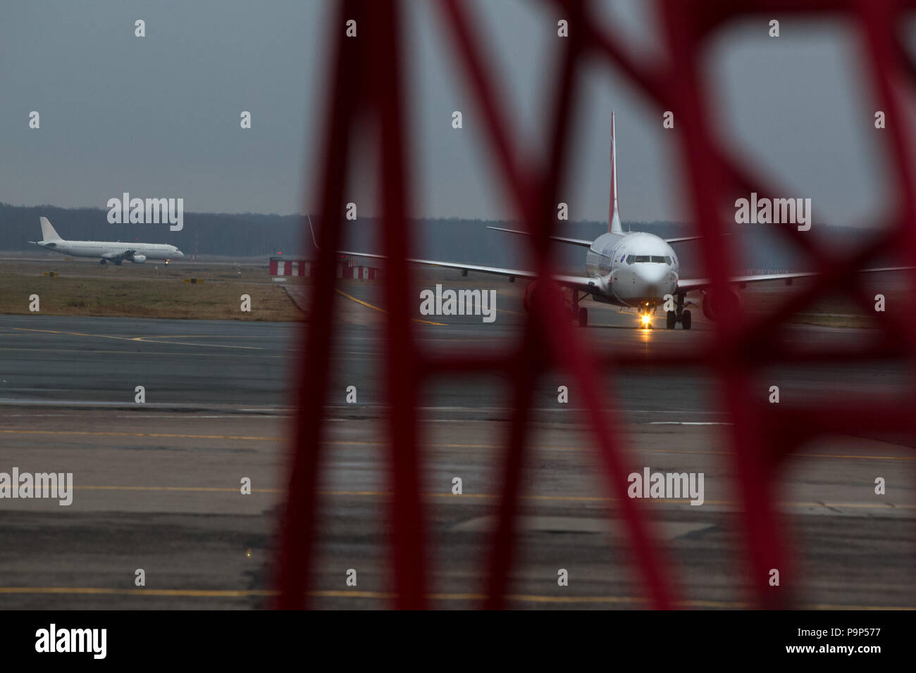 Civil aircraft pictured taxiing to the terminal after arrival at Domodedovo airport, Moscow, Russia - Stock Image