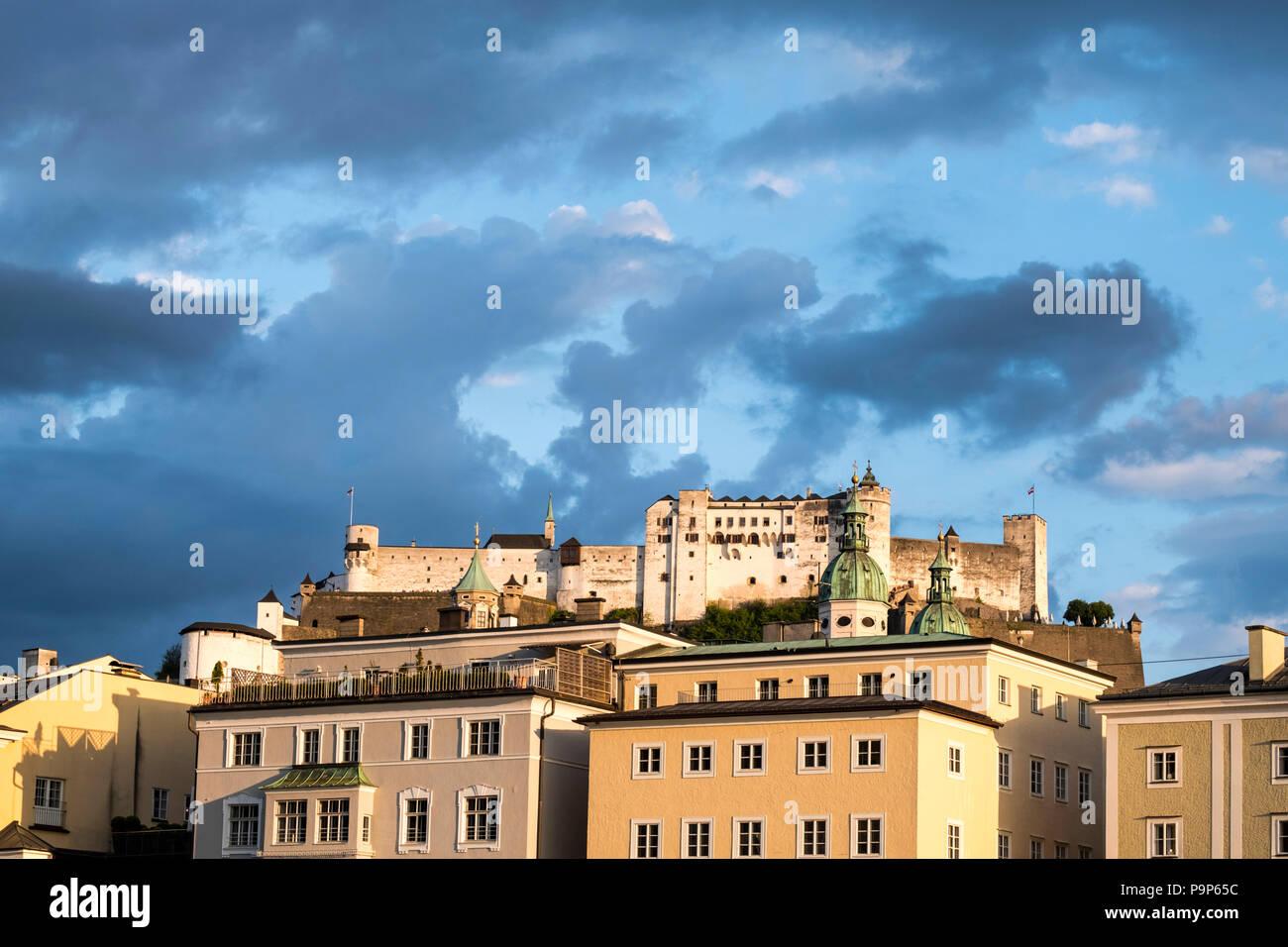 Salzburg cityscape with Fortress Hohensalzburg at dusk - Stock Image