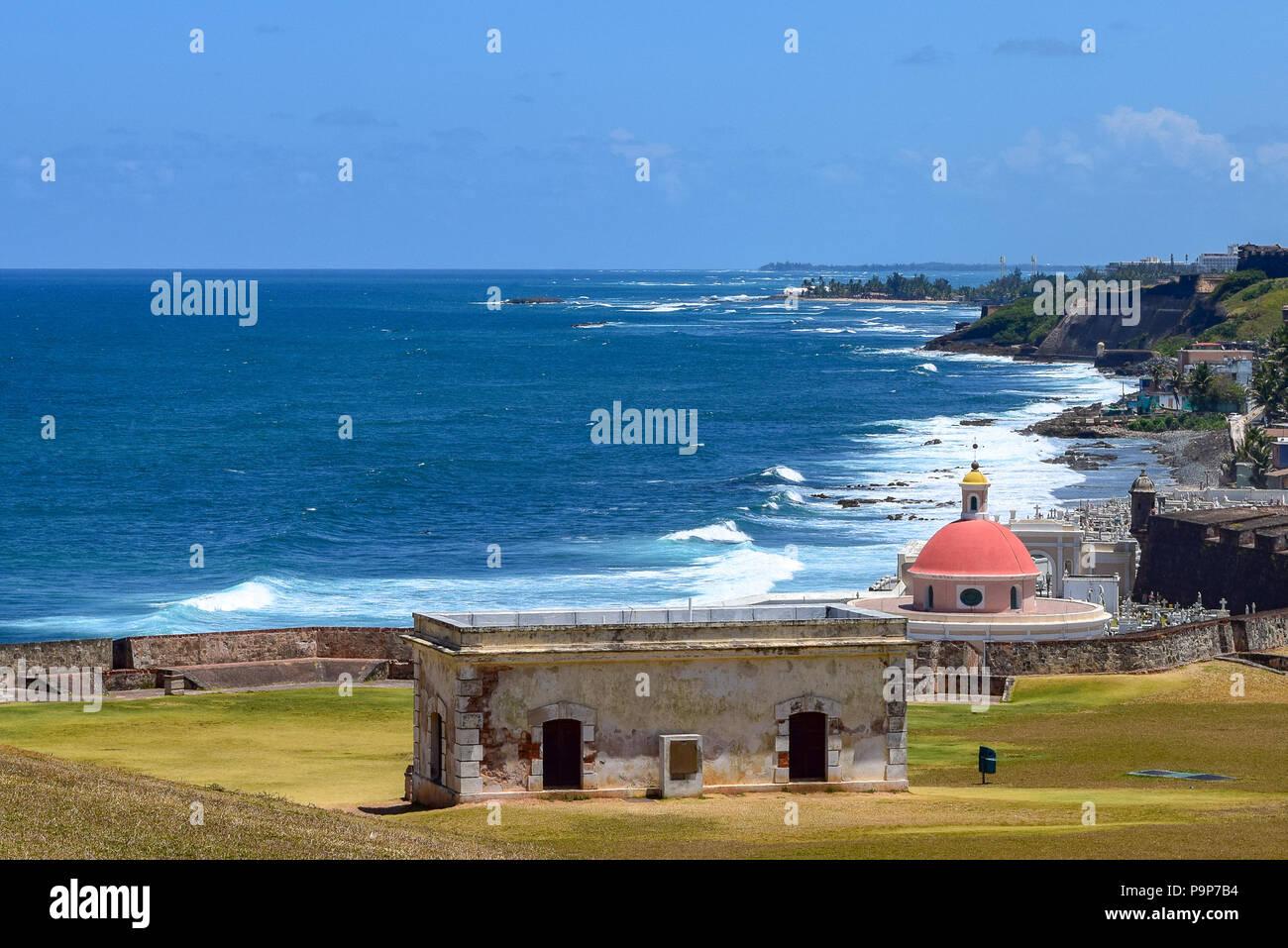 San Juan, Puerto Rico - April 02 2014: Coastline view in Old San Juan overlooking Santa Maria Magdalena de Pazzis Cemetery, which is next to Fort San - Stock Image