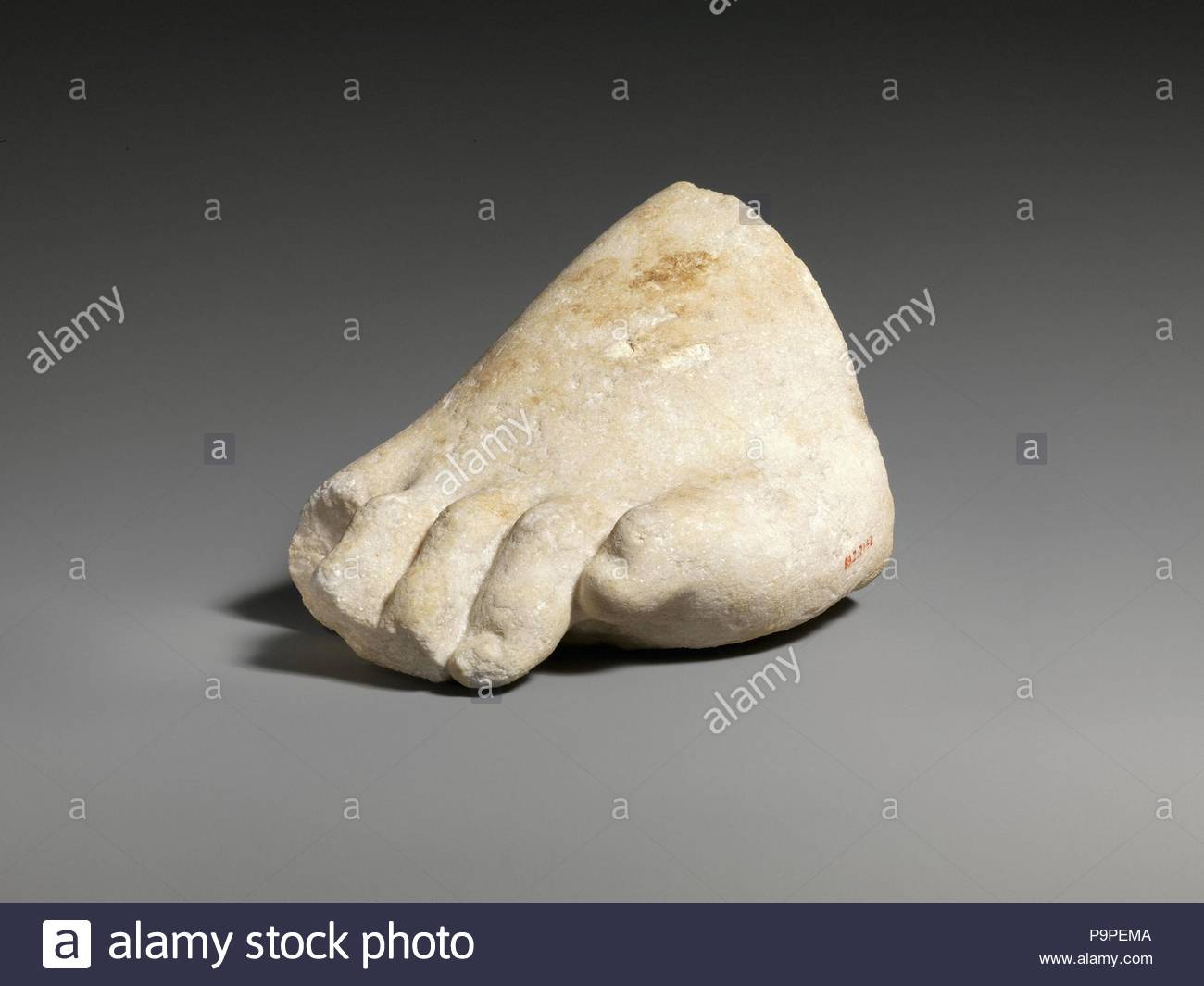 Part of the left foot of a colossal marble statue, Roman, 3rd–2nd century B.C., Greek, Marble, Other: 4 3/4 x 7 5/16 in. (12.1 x 18.6 cm), Stone Sculpture. - Stock Image