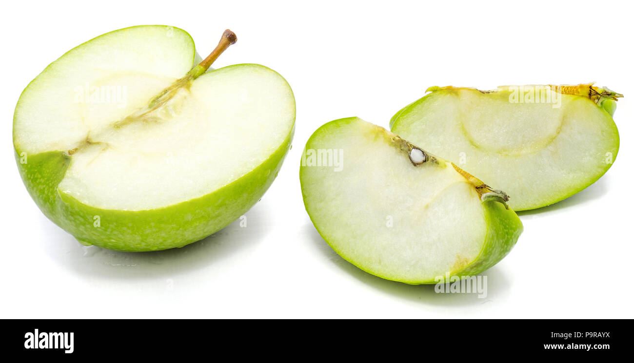 Sliced apple Granny Smith, two slices and one half, isolated on white background - Stock Image
