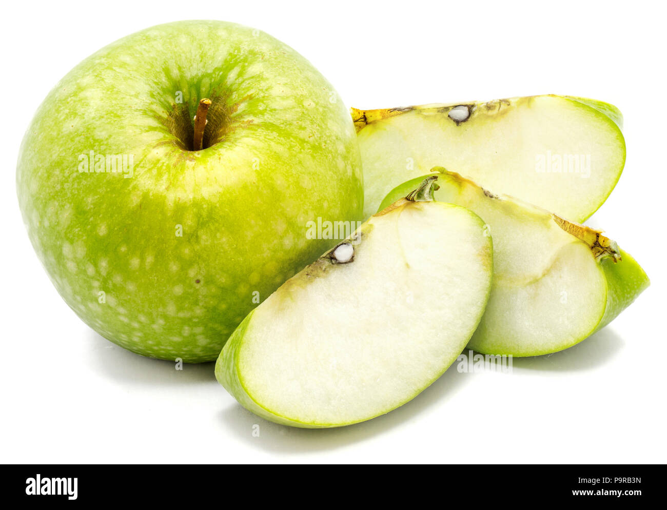 One whole apple Granny Smith and three slices isolated on white background - Stock Image