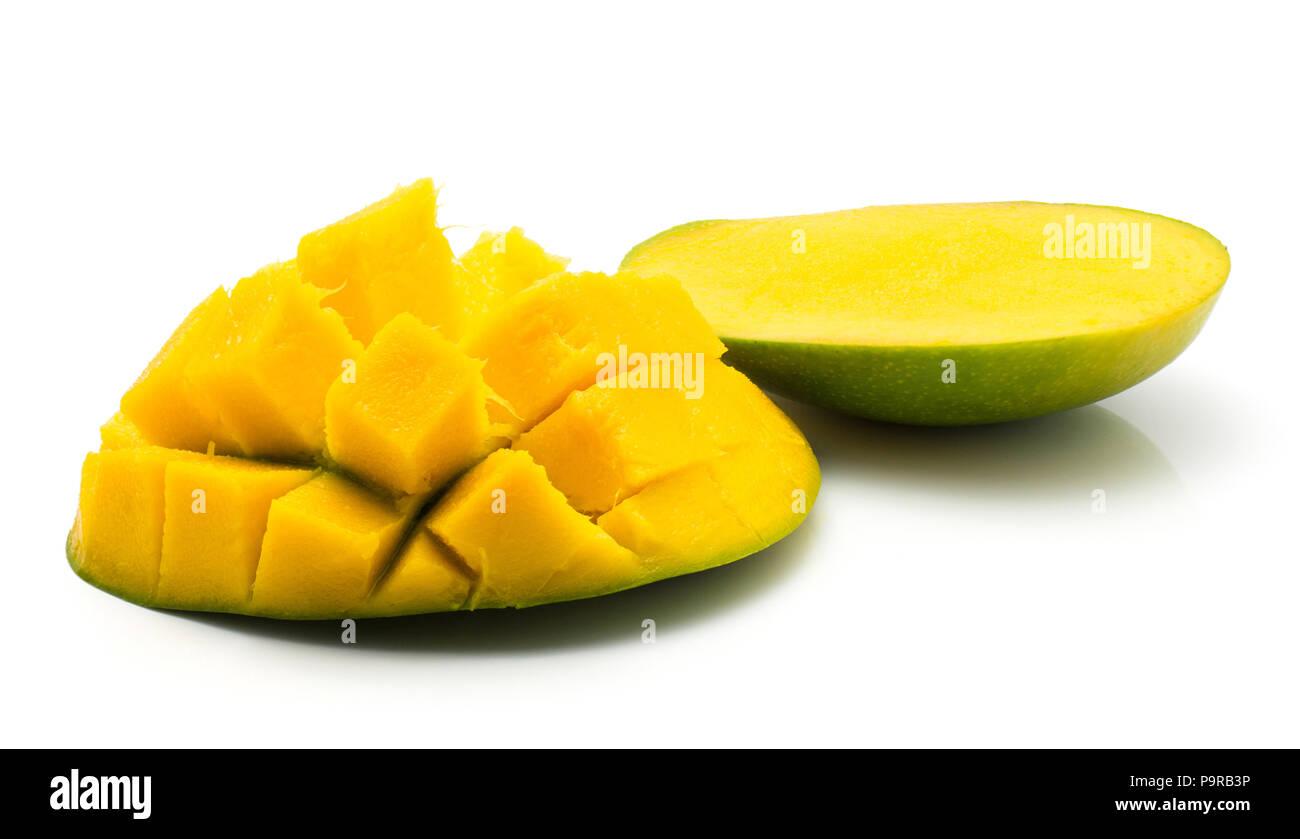 Sliced mango hedgehog shape isolated on white background two halves - Stock Image