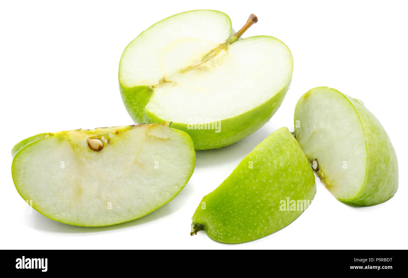 Sliced apple Granny Smith, three slices and one half, isolated on white background - Stock Image