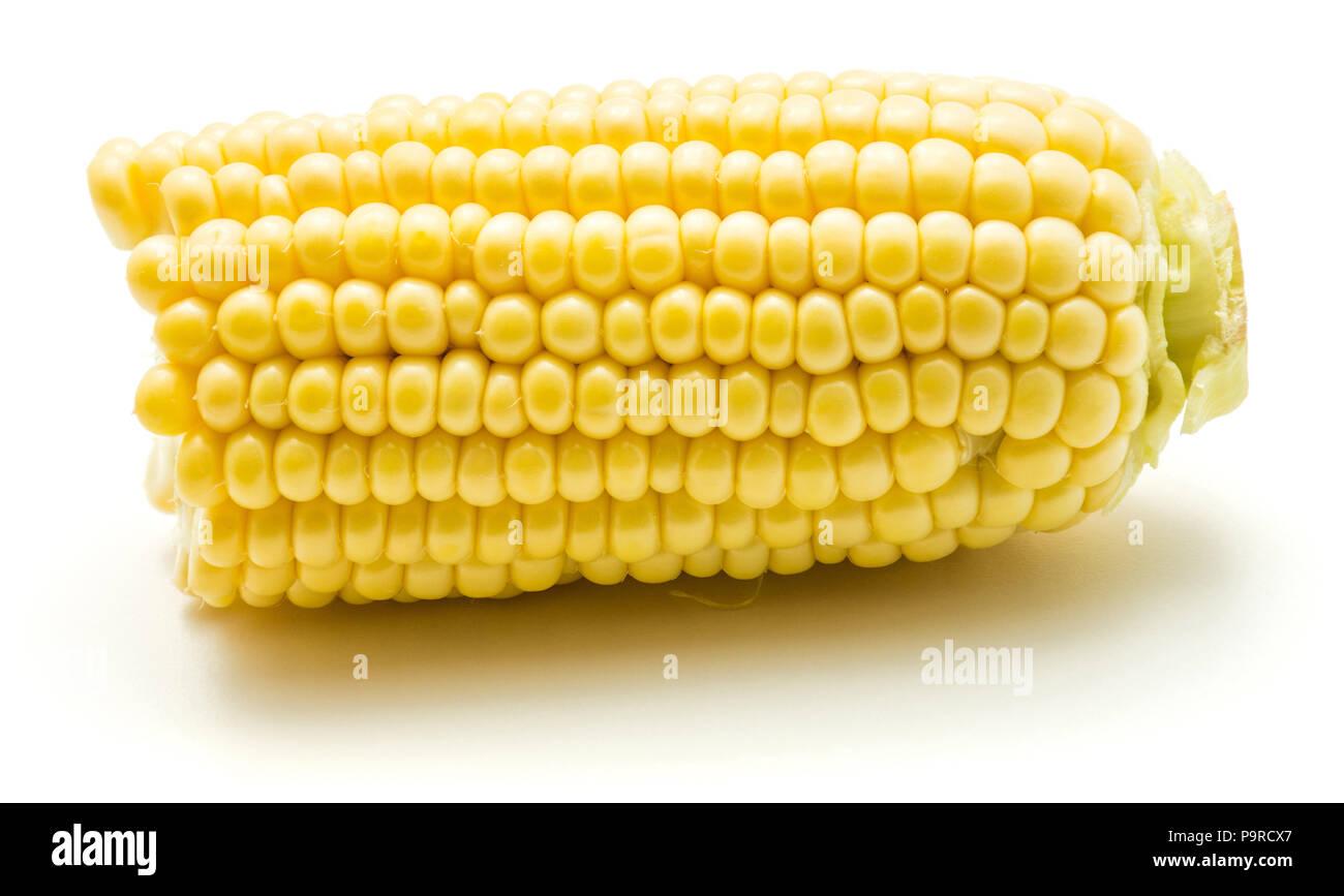 One half of broken open sweet corn isolated on white background Stock Photo