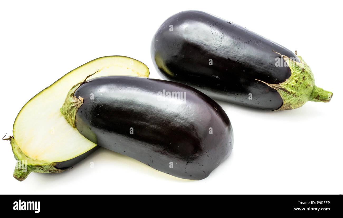 One whole and two halves eggplant (aubergine), longitudinal section, isolated on white background - Stock Image