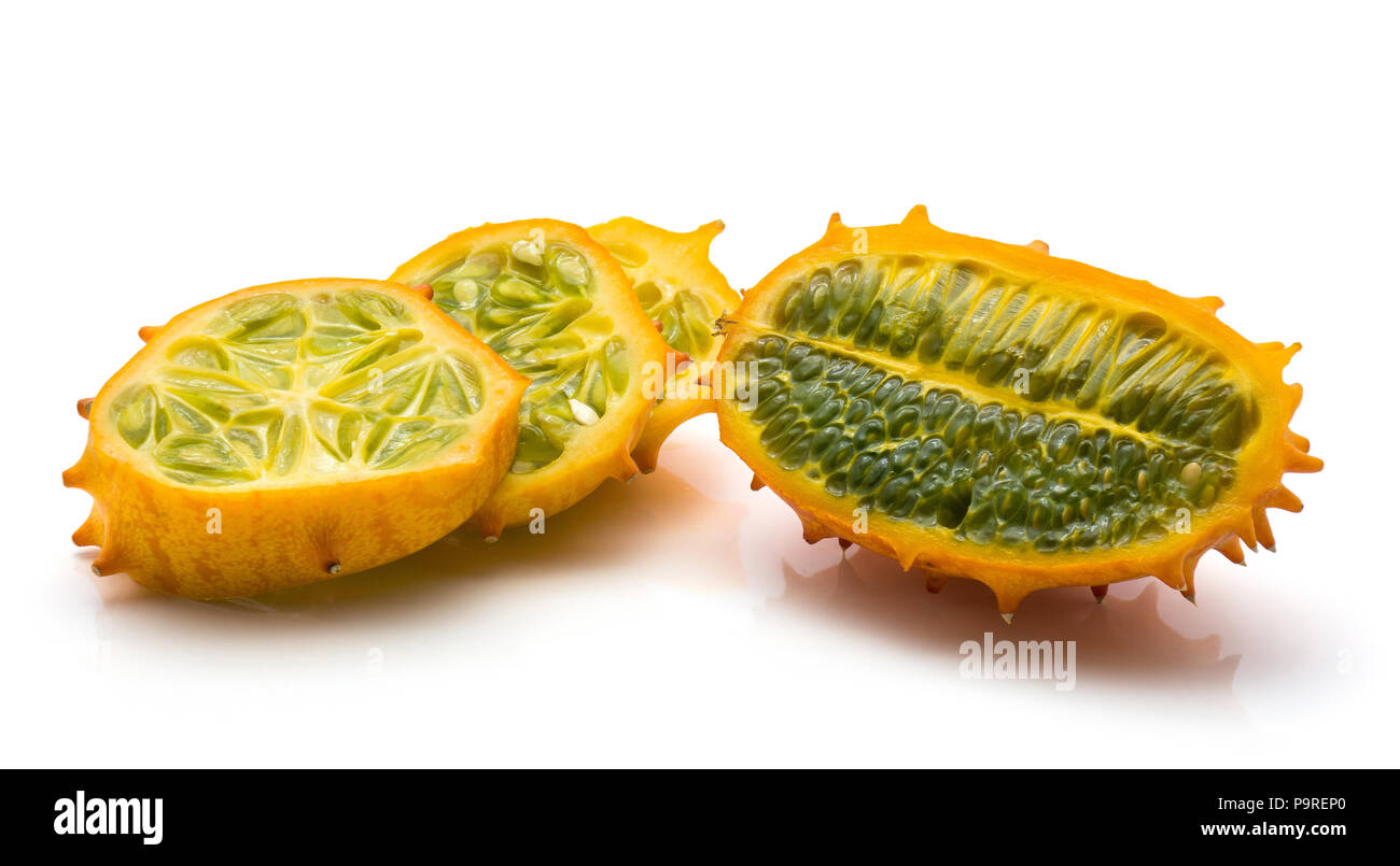 Sliced kiwano isolated on white background one cross section and three slices - Stock Image