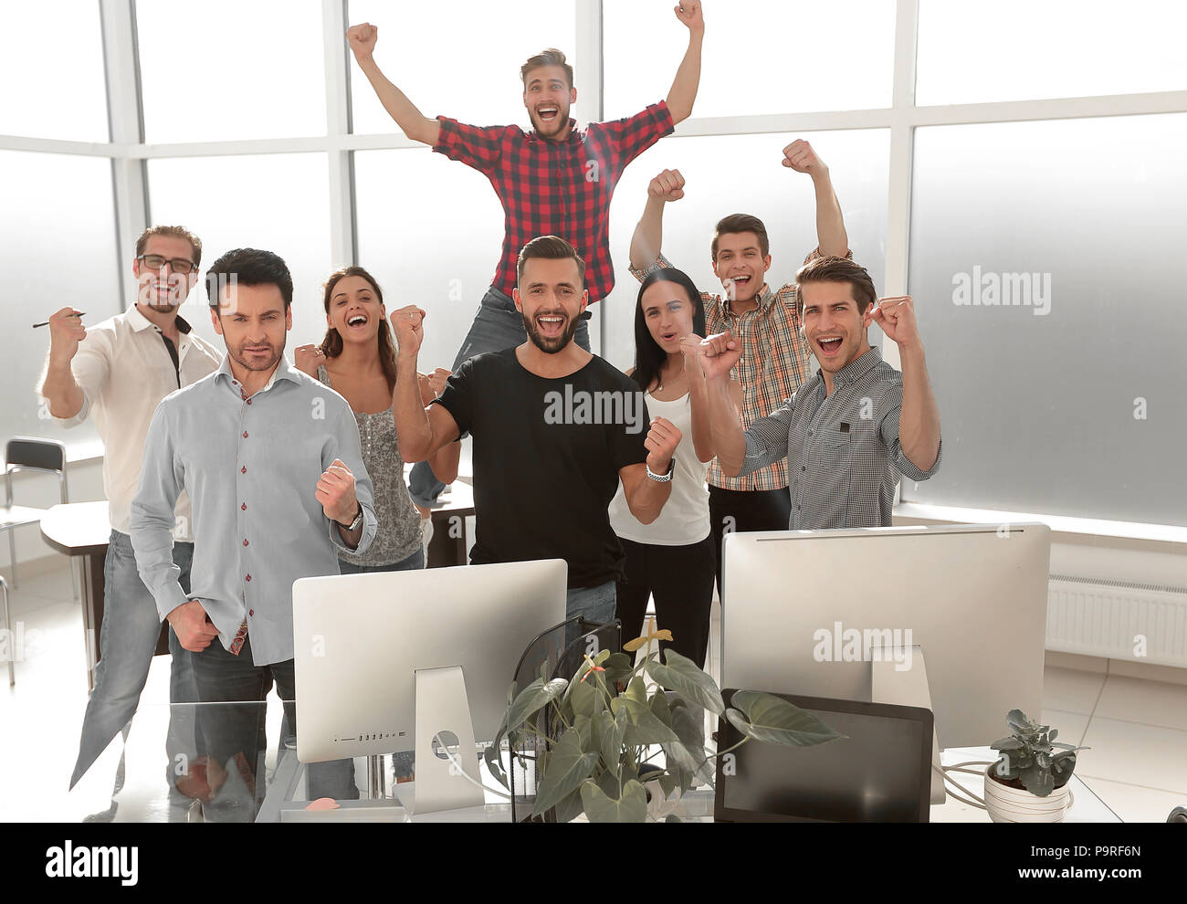 creative business team standing in a bright office - Stock Image