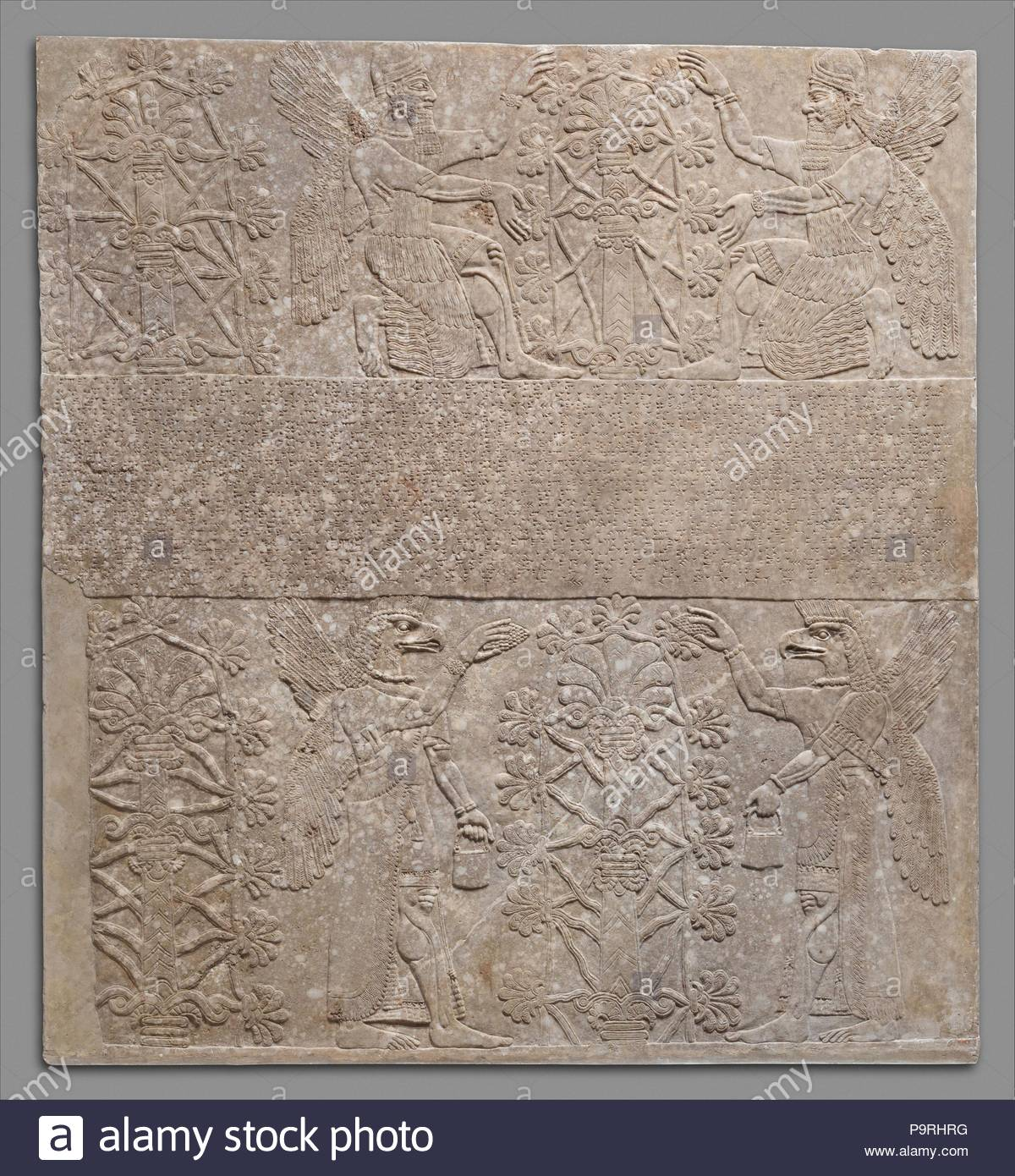 Relief panel, Neo-Assyrian, ca. 883–859 B.C., Mesopotamia, Nimrud (ancient Kalhu), Assyrian, Gypsum alabaster, 90 1/2 x 84 1/2 x 6 in. (229.9 x 214.6 x 15.2 cm), Stone-Reliefs-Inscribed, In most rooms of the Northwest Palace at Nimrud (ancient Kalhu), the reliefs showing magical figures had a single, overlifesize pictorial register, with the inscription in the center cutting across the imagery. - Stock Image