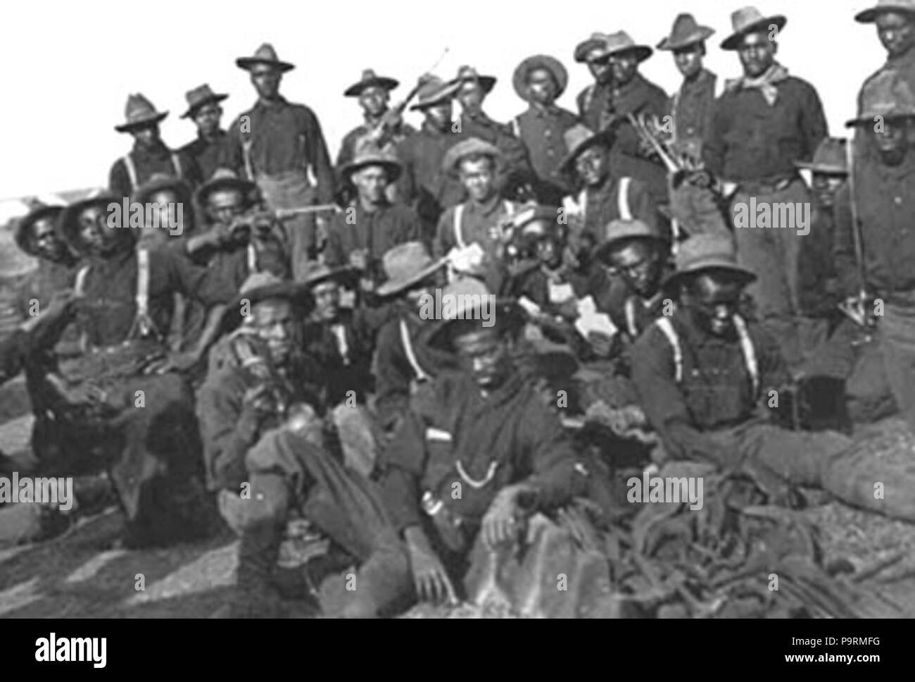 . Buffalo Soldiers of the 10th Cavalry Regiment circa 1898, Augustus Walley (top row, 2nd from right, with the bandana around his neck), a former slave from Bond Avenue in Reisterstown, MD, earned the Medal of Honor. circa 1898 256 BuffaloSoldiersAW Stock Photo