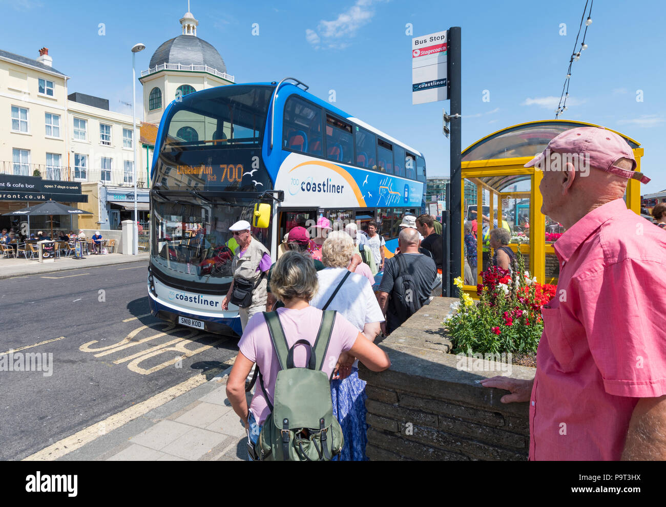 People boarding a new Stagecoach environmentally friendly number 700 Coastliner bus in Summer in Worthing, West Sussex, England, UK. - Stock Image
