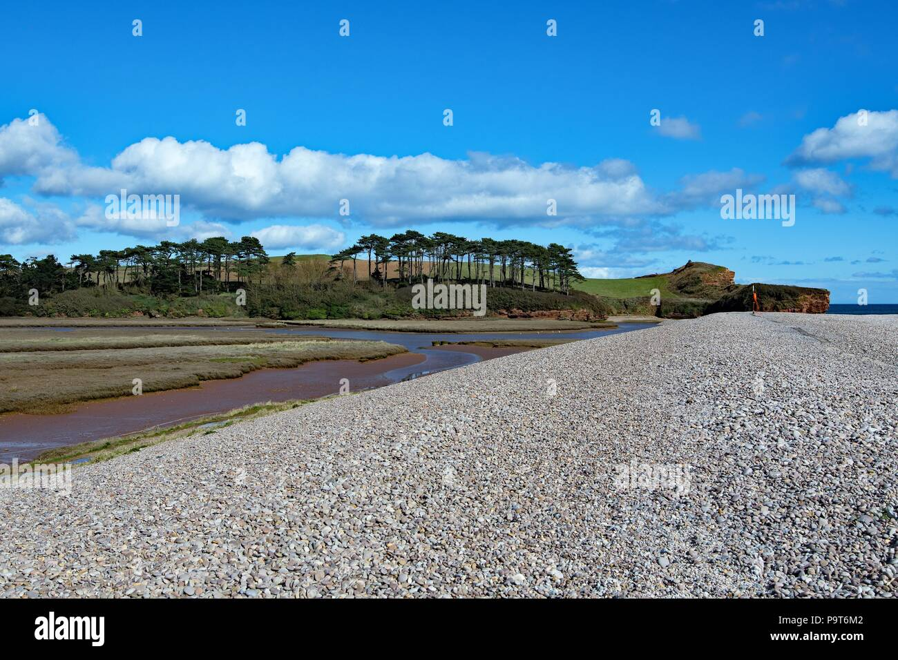 A clear and blue sky day beside the entrance to the River Otter. - Stock Image