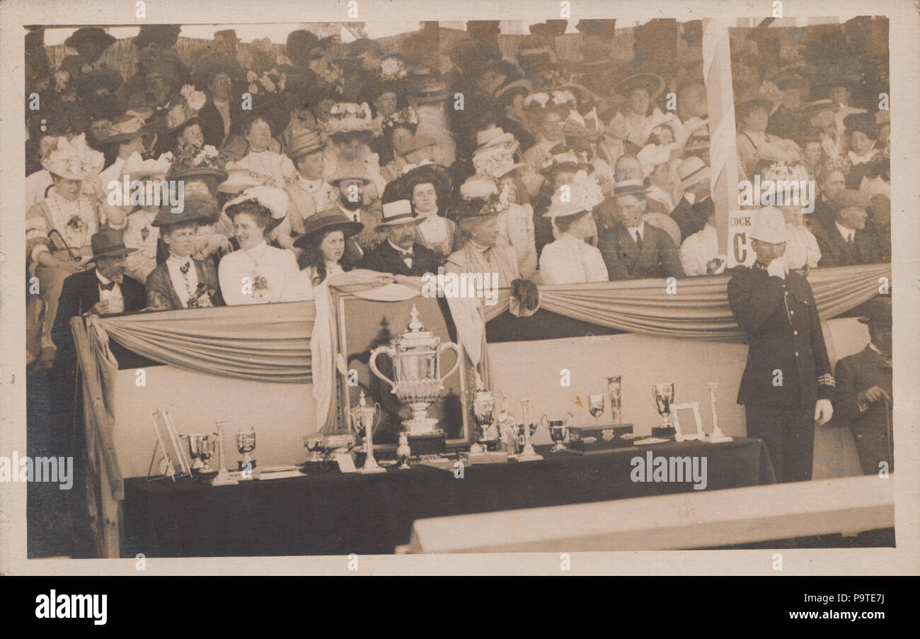 Vintage Photograph of a Public Event Involving The Presentation of Trophies. Police Officer Present. - Stock Image