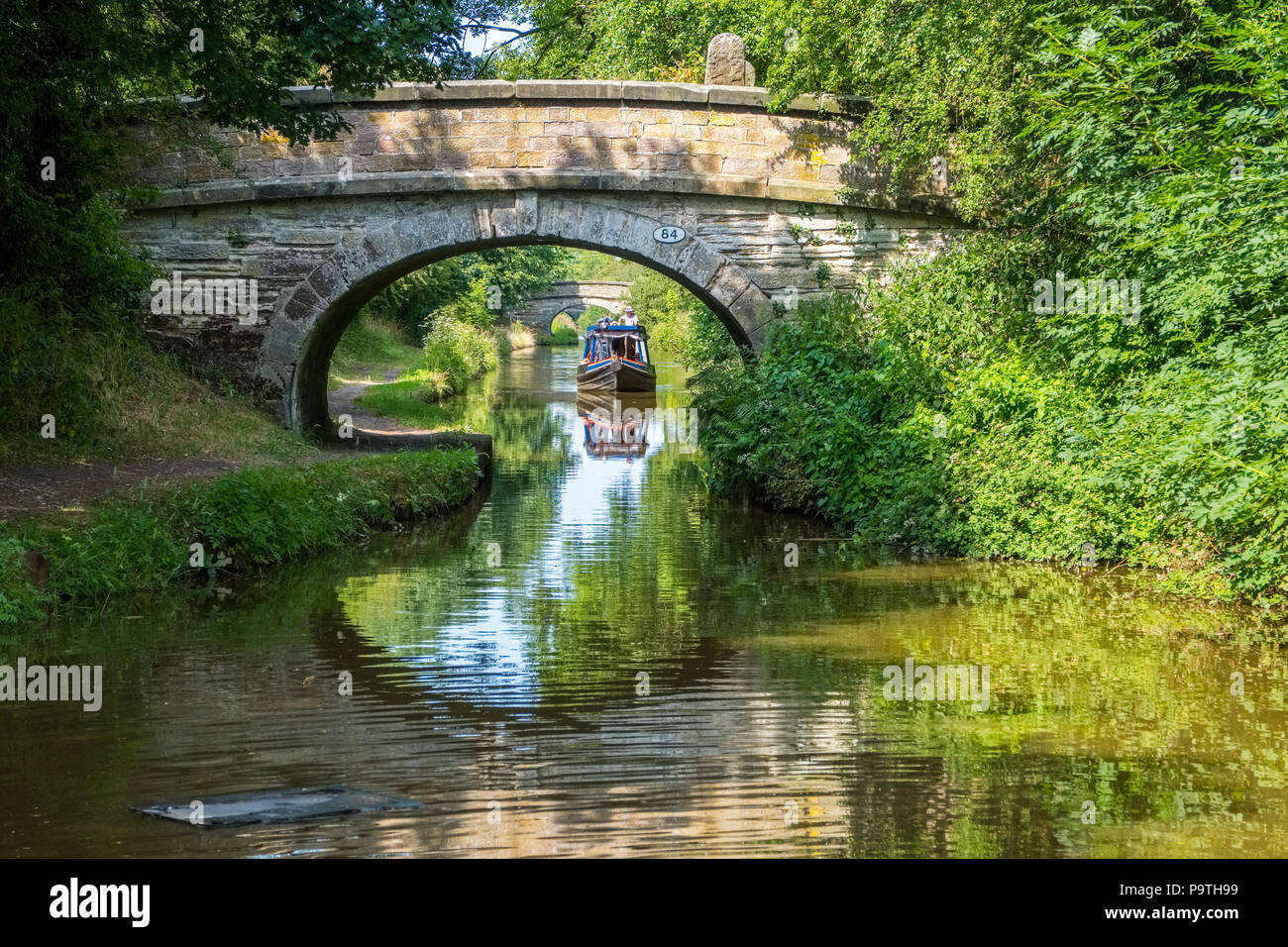 Bridges and narrowboats On the Macclesfield Canal near Congleton in Cheshire - Stock Image