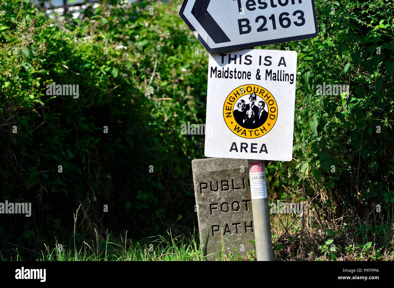 Neighbourhood Watch sign my a footpath and roadside in Boughton Monchelsea village, kent, England. - Stock Image