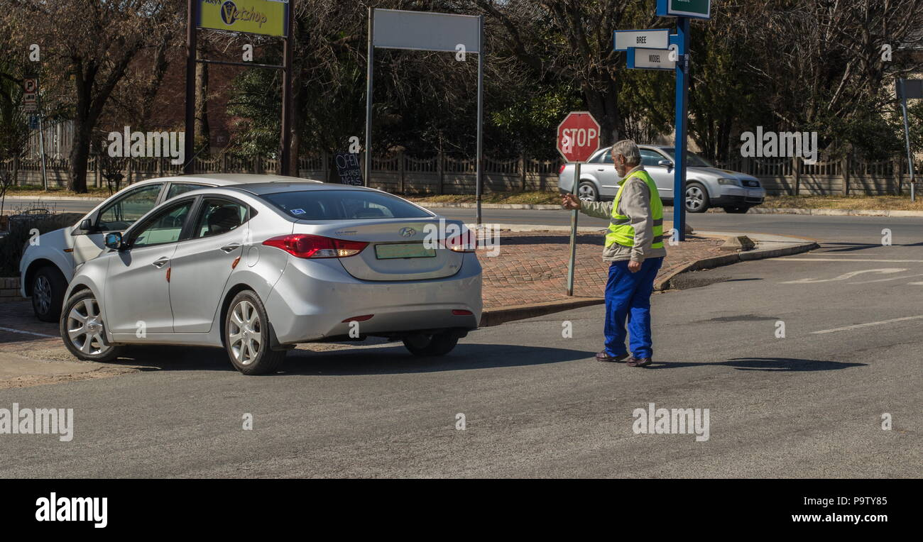 Parys, South Africa - unidentified unemployed caucasian man works as a casual parking attendant to earn some tips image with copy space - Stock Image