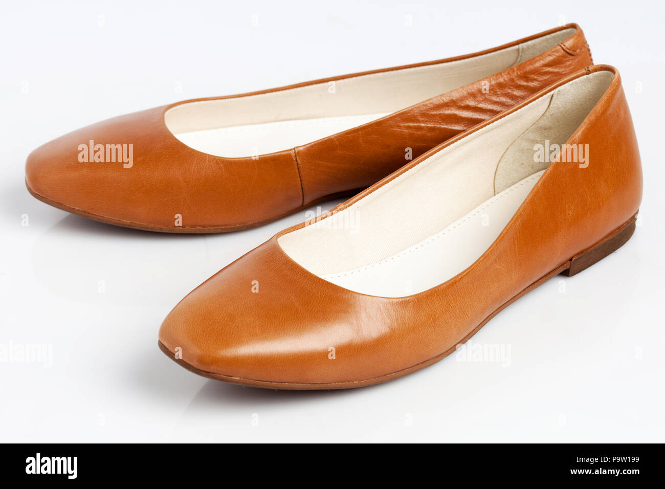 93968504e A pair of ballet flat ladies shoes isolated on white background. - Stock  Image