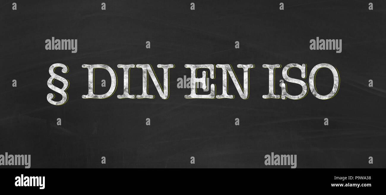 DIN EN ISO abbreviation for german industry standard, european standard and international organization for standardization written with chalk on black - Stock Image