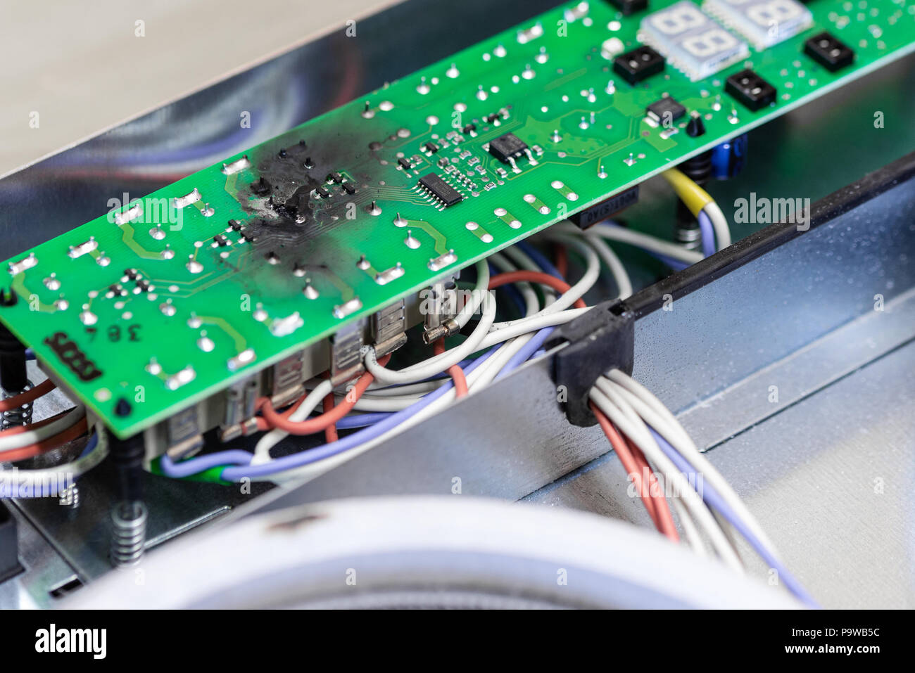 Electrical Short Circuit Stock Photos Wiring Burnt Green Microchip After Due To Water Damage Damaged Overheat Control Panel Board
